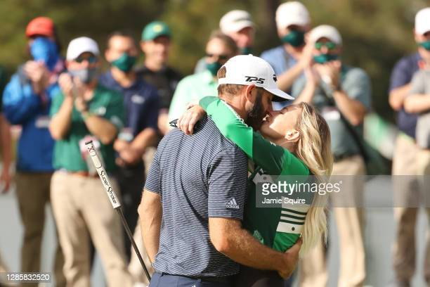 Dustin Johnson of the United States kisses fiancée Paulina Gretzky after winning the Masters at Augusta National Golf Club on November 15, 2020 in...