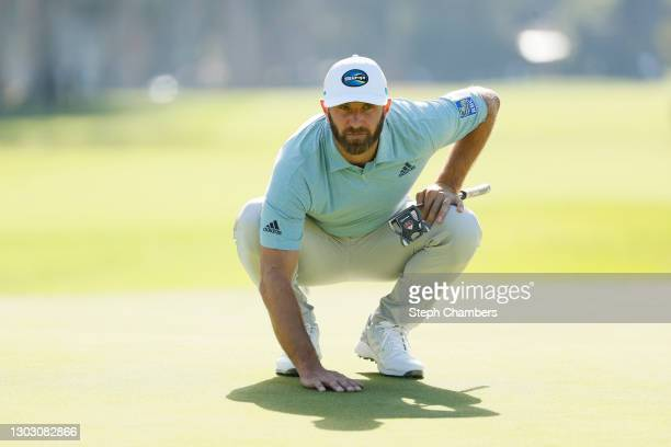 Dustin Johnson of the United States lines up a putt on the 11th green during the second round of The Genesis Invitational at Riviera Country Club on...
