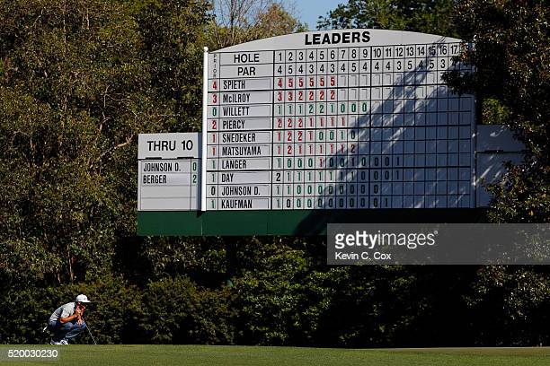 Dustin Johnson of the United States lines up a putt on the 12th green during the third round of the 2016 Masters Tournament at Augusta National Golf...