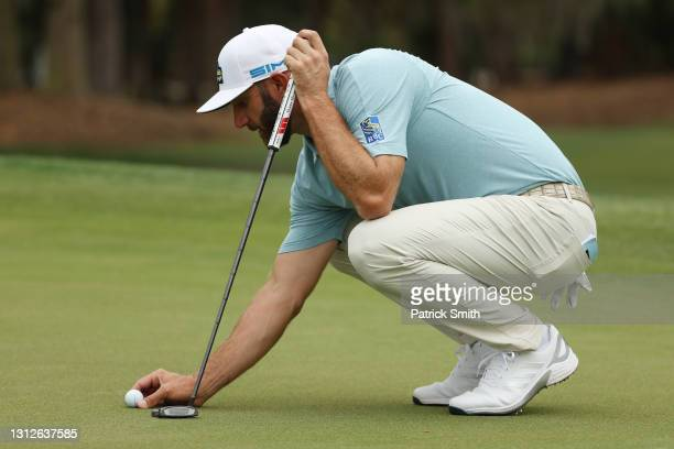 Dustin Johnson of the United States lines up a putt on the 13th green during the first round of the RBC Heritage on April 15, 2021 at Harbour Town...