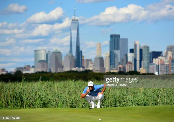 Dustin Johnson of the United States lines up a putt on the 14th green during the third round of The Northern Trust at Liberty National Golf Club on...