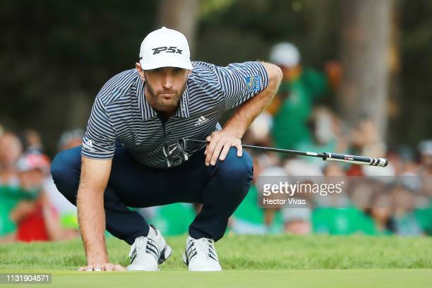 Dustin Johnson of the United States lines up a putt on the 18th green during the final round of World Golf ChampionshipsMexico Championship at Club...