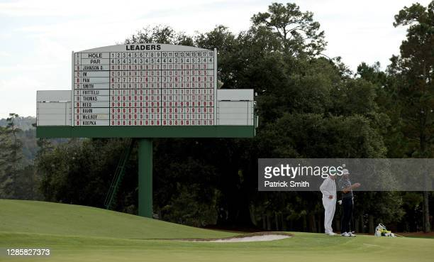 Dustin Johnson of the United States lines up a putt on the 18th green during the final round of the Masters at Augusta National Golf Club on November...