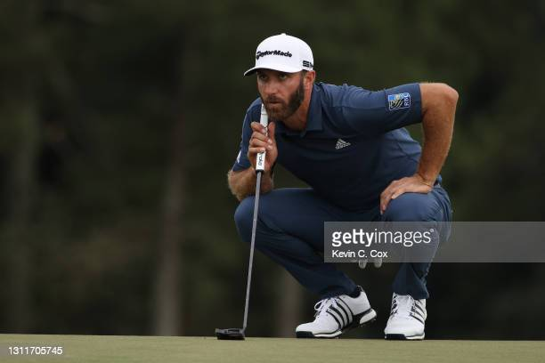 Dustin Johnson of the United States lines up a putt on the 18th green during the second round of the Masters at Augusta National Golf Club on April...