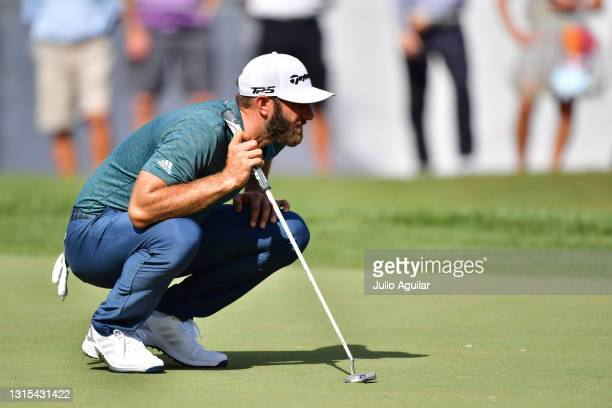 Dustin Johnson of the United States lines up a putt on the 18th green during the second round of the Valspar Championship on the Copperhead Course at...