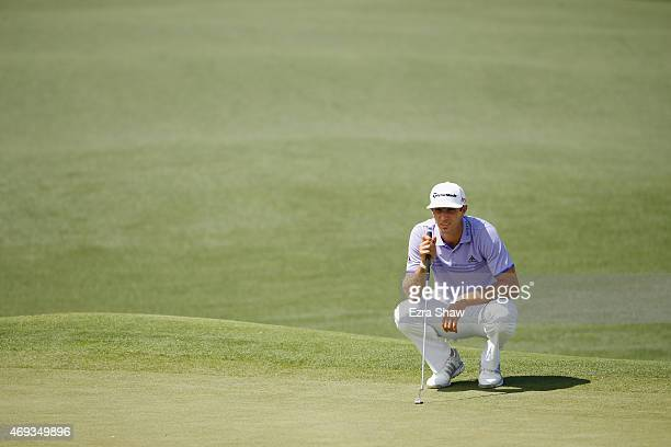 Dustin Johnson of the United States lines up a putt on the second green during the third round of the 2015 Masters Tournament at Augusta National...