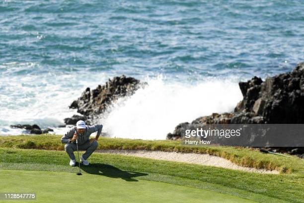Dustin Johnson of the United States lines up a putt on the seventh green during the third round of the ATT Pebble Beach ProAm at Pebble Beach Golf...