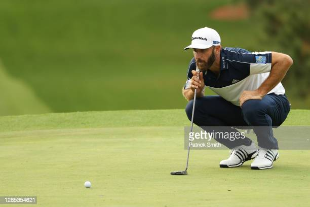Dustin Johnson of the United States lines up a putt on the seventh green during the first round of the Masters at Augusta National Golf Club on...