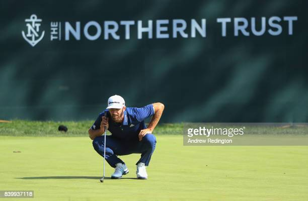 Dustin Johnson of the United States lines up a putt on the tenth green during the final round of The Northern Trust at Glen Oaks Club on August 27...