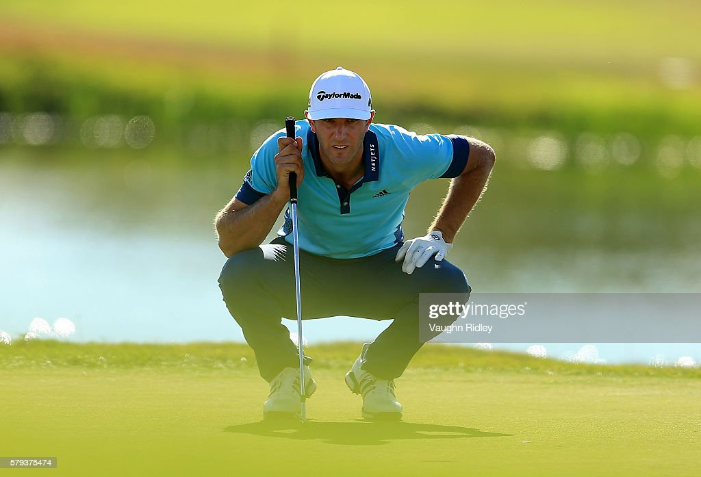 Dustin Johnson of the United States lines up a putt the 18th green during the third round of the RBC Canadian Open at Glen Abbey Golf Club on July 23, 2016 in Oakville, Canada.