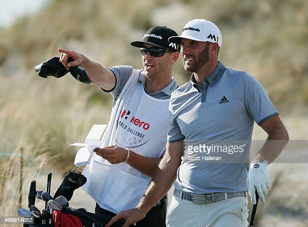 Dustin Johnson of the United States lines up a shot on the 16th tee with his brother/caddie Austin during the first round of the Hero World Challenge...
