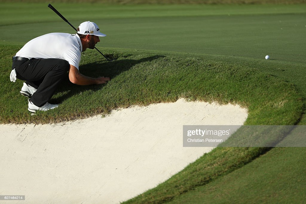 Dustin Johnson of the United States lines up his putt on the 11th hole during round three of the Hero World Challenge at Albany, The Bahamas on December 3, 2016 in Nassau, Bahamas.