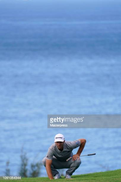 Dustin Johnson of the United States lines up on the 12th green during the final round of the Sentry Tournament of Champions at the Plantation Course...