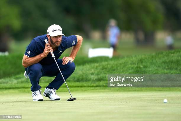 Dustin Johnson of the United States lines up to putt the eighth green during the final round of the BMW Championship on the Course at Olympia Fields...