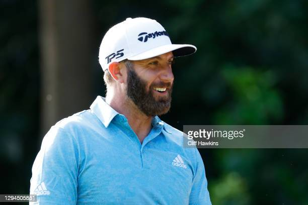 Dustin Johnson of the United States looks on from the range during a practice round prior to the Sentry Tournament Of Champions on the Plantation...