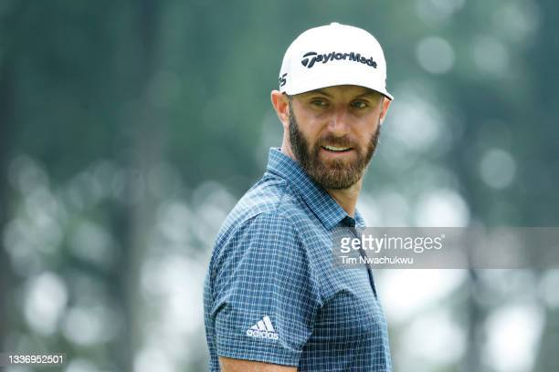Dustin Johnson of the United States looks on over the first green during the third round of the BMW Championship at Caves Valley Golf Club on August...