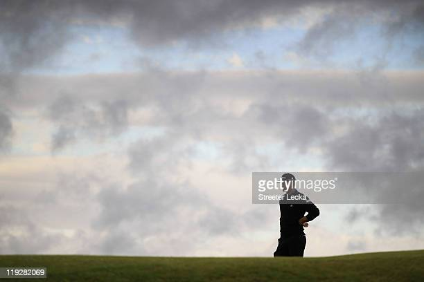 Dustin Johnson of the United States looks out during the third round of The 140th Open Championship at Royal St George's on July 16 2011 in Sandwich...