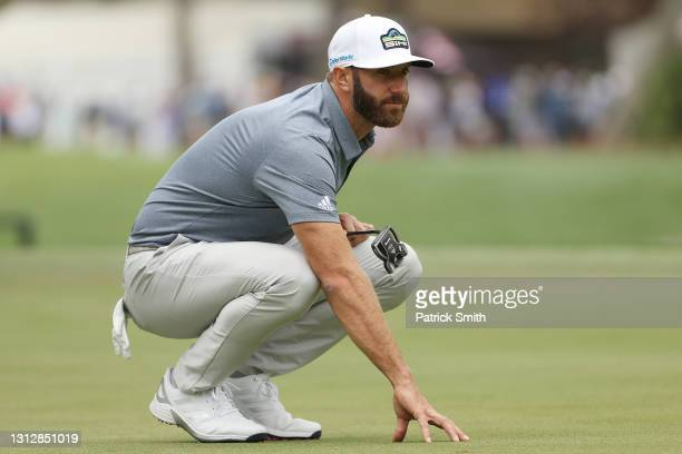 Dustin Johnson of the United States looks over a putt on the seventh green during the second round of the RBC Heritage on April 16, 2021 at Harbour...