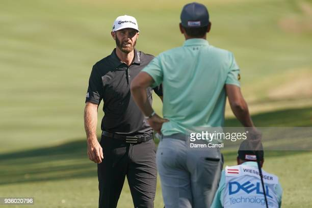 Dustin Johnson of the United States looks to Bernd Wiesberger of Austria on the 15th hole during the first round of the World Golf ChampionshipsDell...