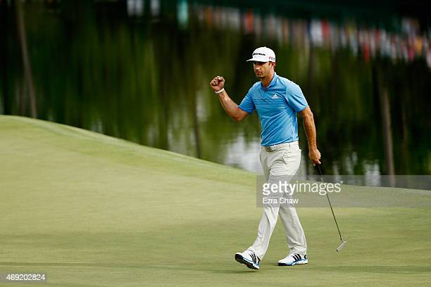 Dustin Johnson of the United States makes a long birdie putt on the 16th green during the second round of the 2015 Masters Tournament at Augusta...