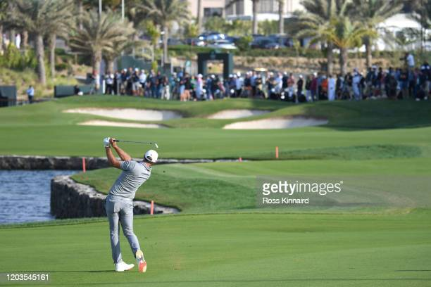 Dustin Johnson of The United States of America plays his second shot on the 18th hole during Day 4 of the Saudi International at Royal Greens Golf...