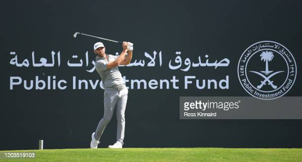 Dustin Johnson of The United States of America tees off on the 3rd hole during Day 4 of the Saudi International at Royal Greens Golf and Country Club...