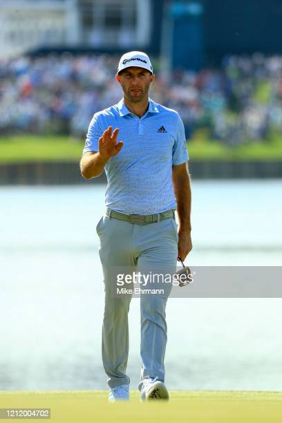 Dustin Johnson of the United States on the 18th green during the first round of The PLAYERS Championship on The Stadium Course at TPC Sawgrass on...