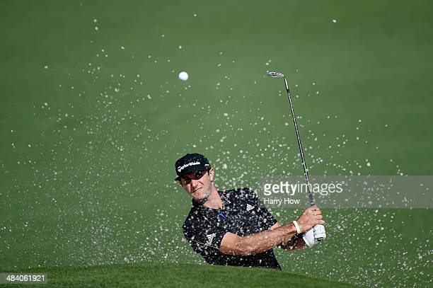Dustin Johnson of the United States plays a bunker shot on the second hole during the second round of the 2014 Masters Tournament at Augusta National...