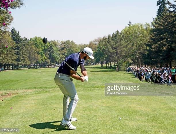 Dustin Johnson of the United States plays a driver from the second tee during the final round of the World Golf Championships-Mexico Championship at...