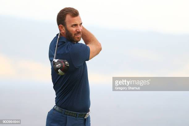 Dustin Johnson of the United States plays a shot during the proam tournament prior to the Sentry Tournament of Champions at Plantation Course at...