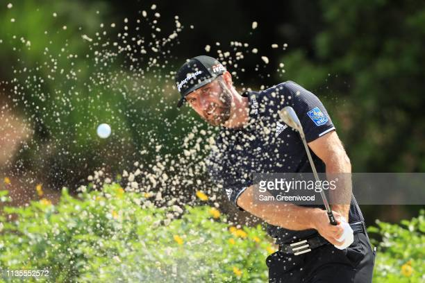 Dustin Johnson of the United States plays a shot from a bunker during a practice round for The PLAYERS Championship on The Stadium Course at TPC...