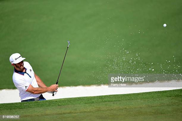 Dustin Johnson of the United States plays a shot from a bunker on the second hole during the first round of the 2016 Masters Tournament at Augusta...