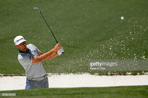 Dustin Johnson of the United States plays a shot from a bunker on the second hole during the third round of the 2016 Masters Tournament at Augusta...