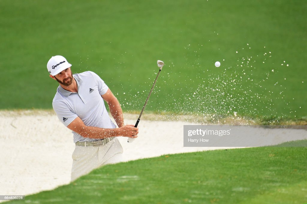 Dustin Johnson of the United States plays a shot from a bunker on the tenth hole during a practice round prior to the start of the 2017 Masters Tournament at Augusta National Golf Club on April 5, 2017 in Augusta, Georgia.