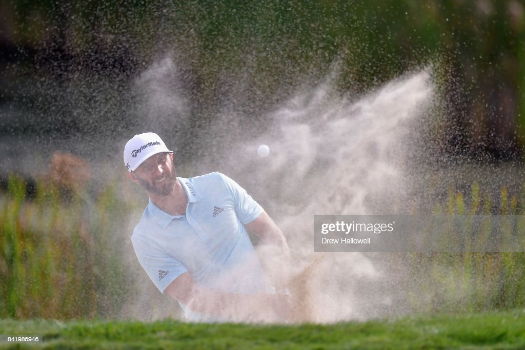 Dustin Johnson of the United States plays a shot from a bunker on the tenth hole during round two of the Dell Technologies Championship at TPC Boston on September 2, 2017 in Norton, Massachusetts.