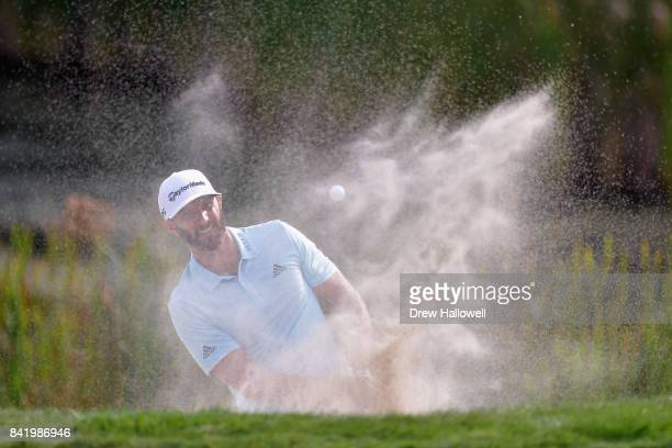 Dustin Johnson of the United States plays a shot from a bunker on the tenth hole during round two of the Dell Technologies Championship at TPC Boston...