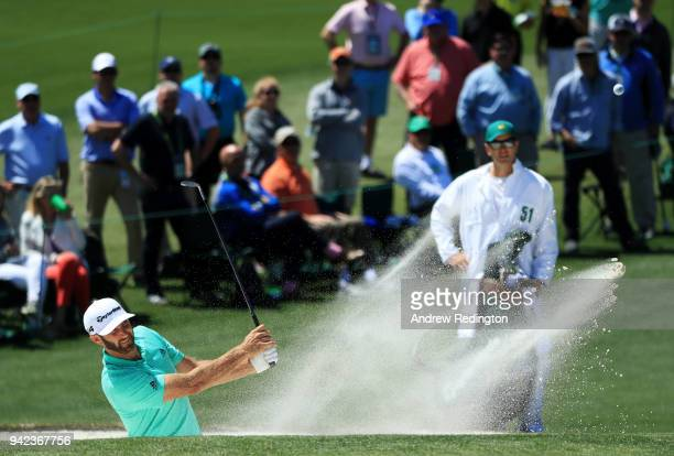 Dustin Johnson of the United States plays a shot from a bunker on the second hole during the first round of the 2018 Masters Tournament at Augusta...