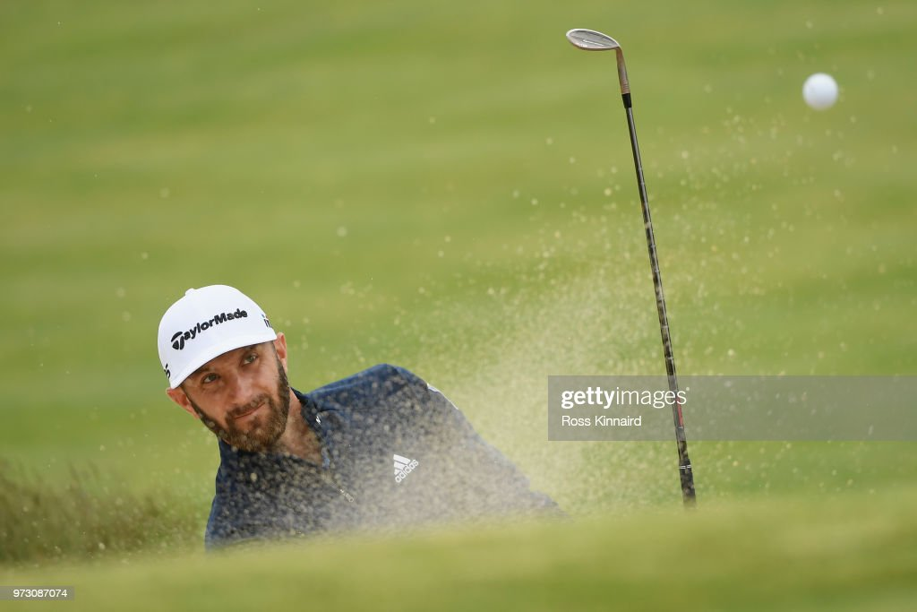 Dustin Johnson of the United States plays a shot from a bunker on the 11th hole during a practice round prior to the 2018 U.S. Open at Shinnecock Hills Golf Club on June 13, 2018 in Southampton, New York.