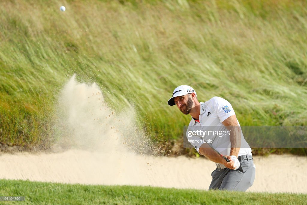 Dustin Johnson of the United States plays a shot from a bunker on the 14th hole during the first round of the 2018 U.S. Open at Shinnecock Hills Golf Club on June 14, 2018 in Southampton, New York.