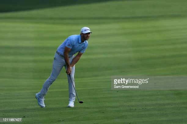 Dustin Johnson of the United States plays a shot on the 11th hole during the first round of The PLAYERS Championship on The Stadium Course at TPC...