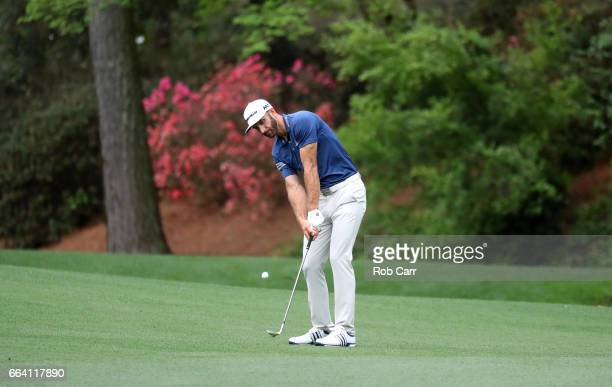 Dustin Johnson of the United States plays a shot on the 13th hole during a practice round prior to the start of the 2017 Masters Tournament at...