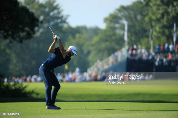 Dustin Johnson of the United States plays a shot on the 14th hole during the second round of the 2018 PGA Championship at Bellerive Country Club on...