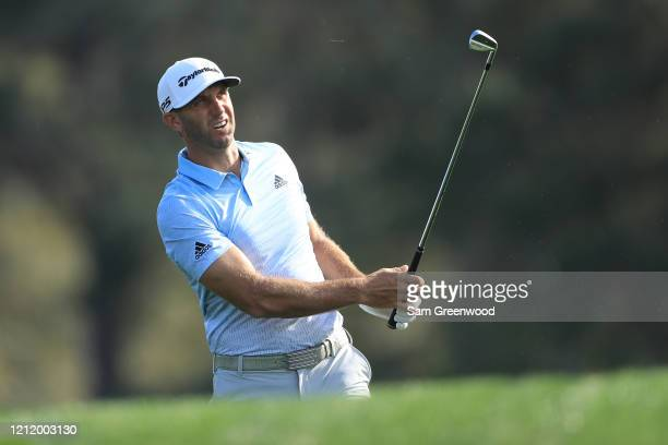 Dustin Johnson of the United States plays a shot on the 14th hole during the first round of The PLAYERS Championship on The Stadium Course at TPC...