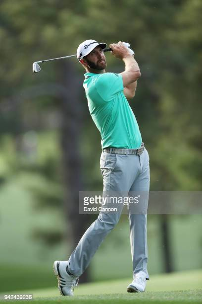 Dustin Johnson of the United States plays a shot on the 17th hole during the first round of the 2018 Masters Tournament at Augusta National Golf Club...