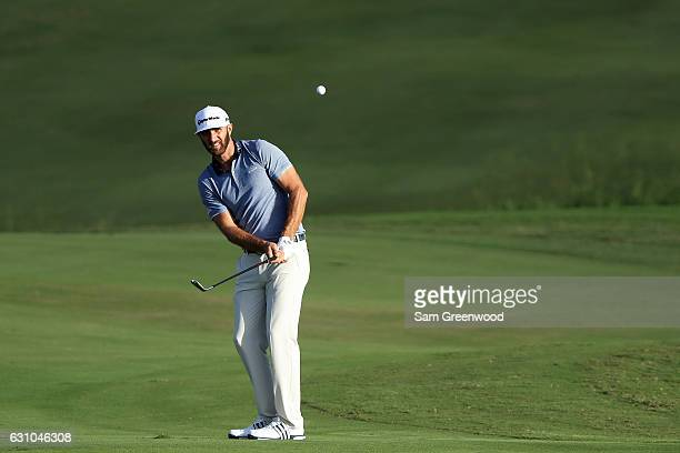 Dustin Johnson of the United States plays a shot on the 18th hole during the first round of the SBS Tournament of Champions at the Plantation Course...