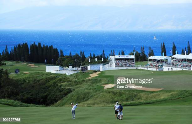 Dustin Johnson of the United States plays a shot on the 18th hole during the third round of the Sentry Tournament of Champions at Plantation Course...