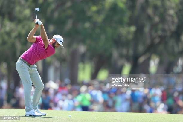 Dustin Johnson of the United States plays a shot on the fifth hole during the second round of THE PLAYERS Championship at the Stadium course at TPC...
