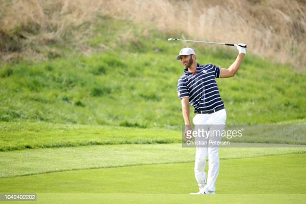 Dustin Johnson of the United States plays a shot on the fourth hole during the afternoon foursome matches of the 2018 Ryder Cup at Le Golf National...