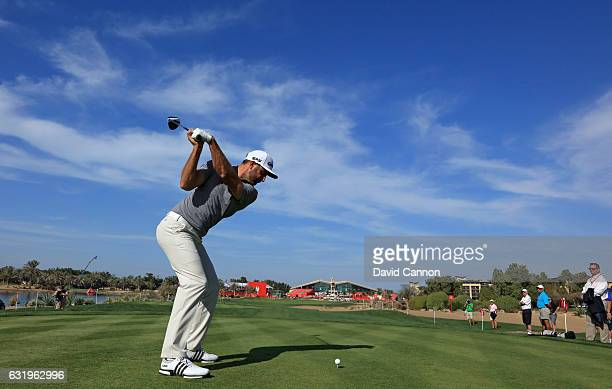 Dustin Johnson of the United States plays a shot on the ninth hole during the proam for the 2017 Abu Dhabi HSBC Golf Championship at Abu Dhabi Golf...