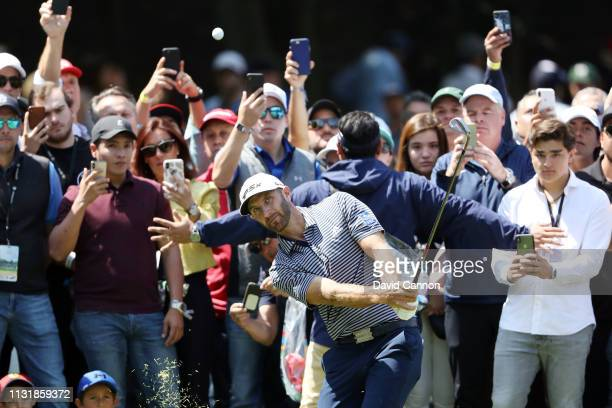 Dustin Johnson of the United States plays a shot on the second hole during the final round of World Golf Championships-Mexico Championship at Club de...